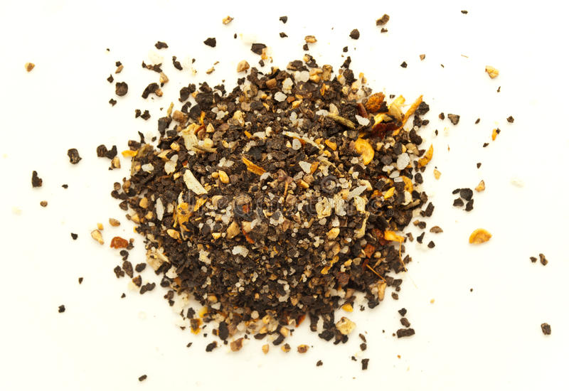 Pile of ground pepper isolated. A mixture of peppers with salt and dried vegetables. Ground black pepper isolated on white background. Pile of ground pepper royalty free stock image