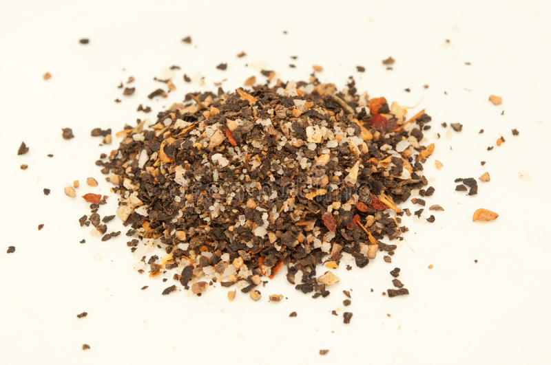 Pile of ground pepper isolated. A mixture of peppers with salt and dried vegetables. Ground black pepper isolated on white background. Pile of ground pepper stock images