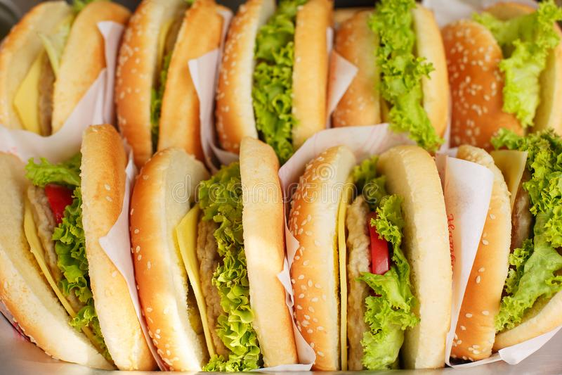 Pile of hamburgers on a tray. royalty free stock photos