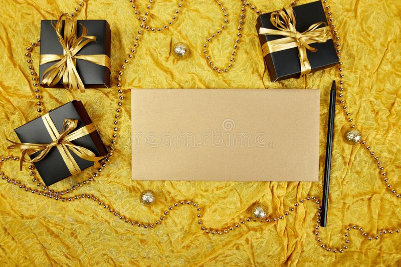 Pile of handmade luxury black gift boxes with gold ribbon DIY decoration, blank sheet paper for greeting text, gold wedding. Invitation. Birthday, christmas stock photography