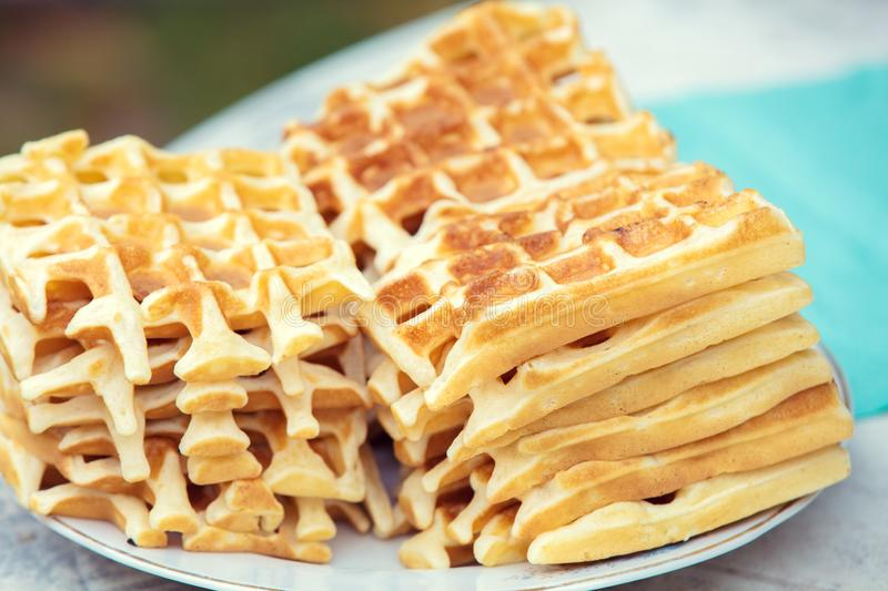 A pile of homemade Belgian Waffles stock images