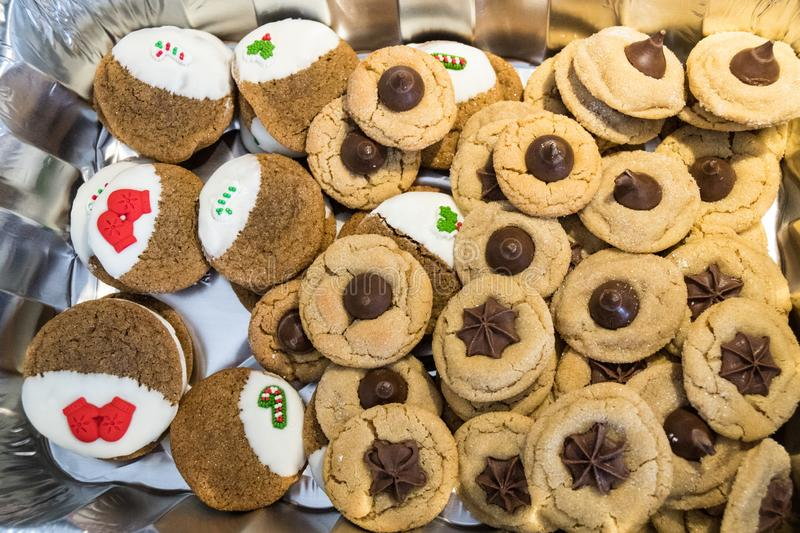 Pile of homemade Christmas cookies - peanut butter kisses and ginger cookies royalty free stock image