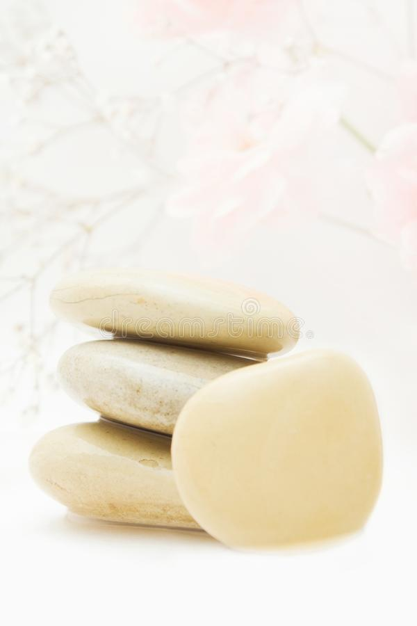 pile of hot massage stones - beauty, spa and body care styled concept royalty free stock photography