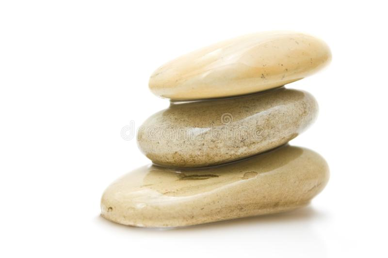 Pile of hot massage stones - beauty, spa and body care styled concept. Elegant visuals royalty free stock photo