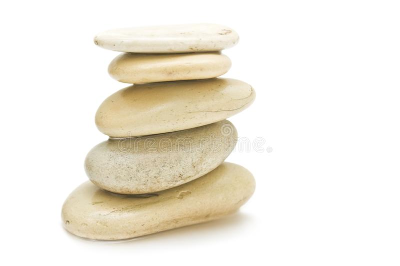 Pile of hot massage stones - beauty, spa and body care styled concept. Elegant visuals stock photo
