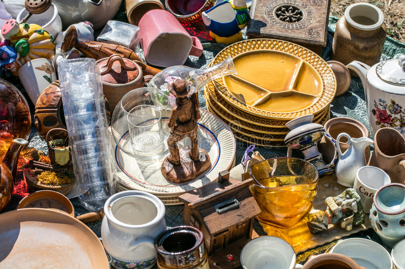 Pile of household things and decorative objects at welfare. Pile of household things, various dishes and decorative objects at boot sale for second hand royalty free stock photography