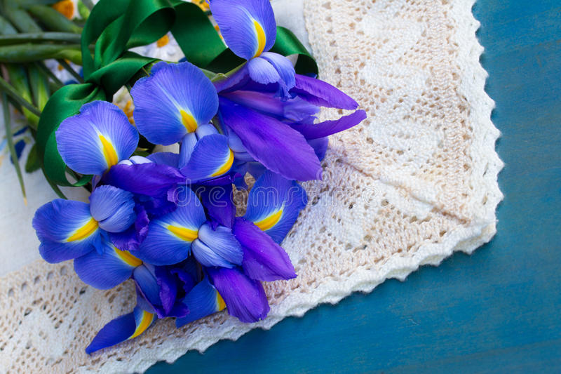 Pile of iris flowers on blue royalty free stock photos