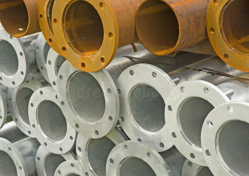 Pile of iron and steel pipes. stock photo