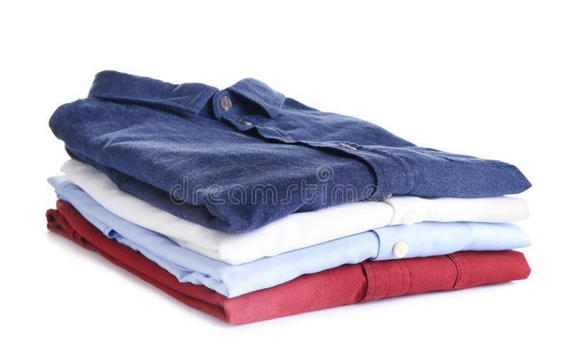 Pile of ironed clothes on white. Pile of ironed clothes isolated on white stock image