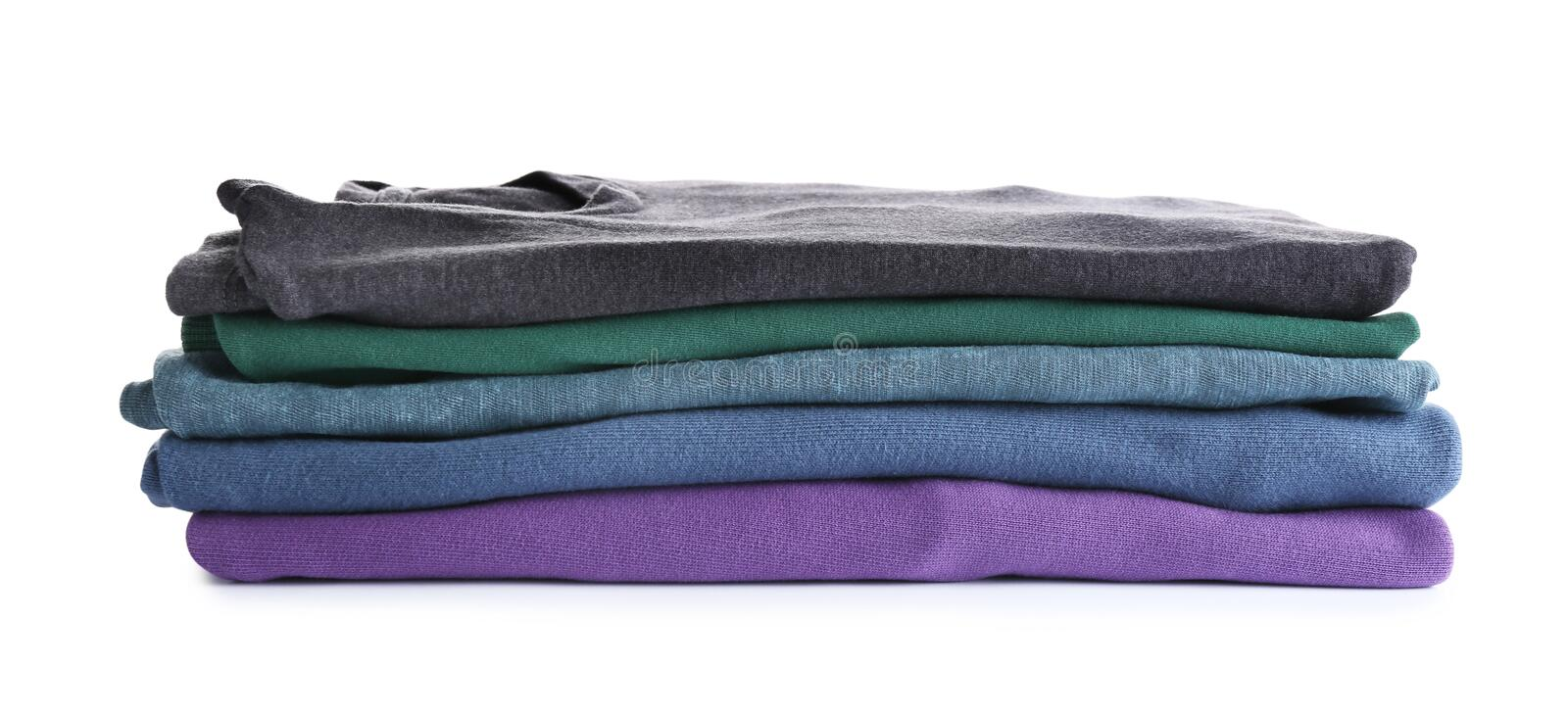 Pile of ironed clothes on white. Pile of ironed clothes isolated on white stock photos