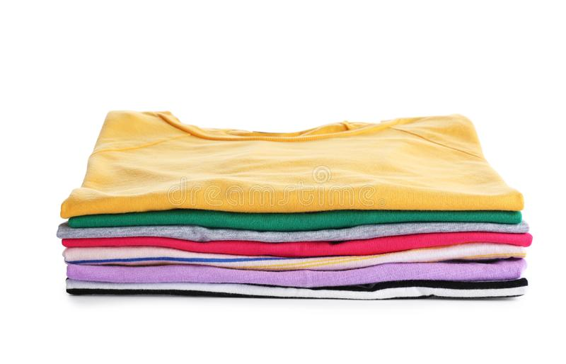 Pile of ironed clothes isolated. On white stock images