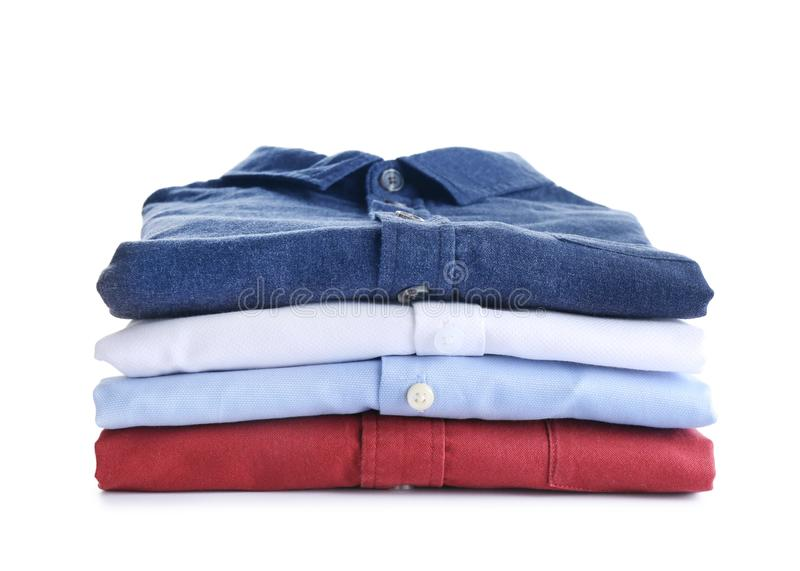 Pile of ironed clothes on white. Pile of ironed clothes isolated on white royalty free stock images