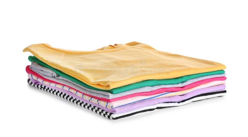Pile of ironed clothes on white. Pile of ironed clothes isolated on white royalty free stock photography