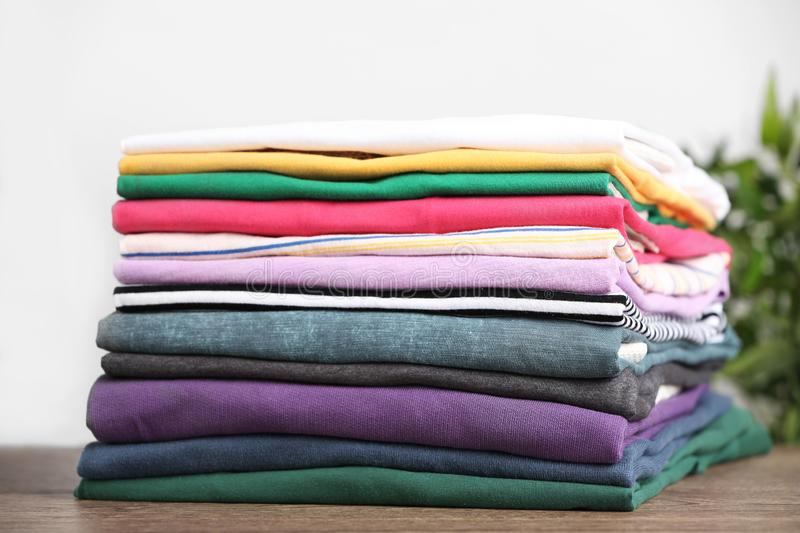 Pile of ironed clothes on table. Closeup stock photography