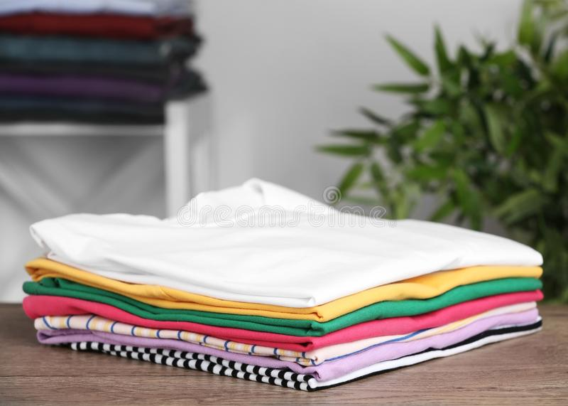 Pile of ironed clothes on table. In room royalty free stock images