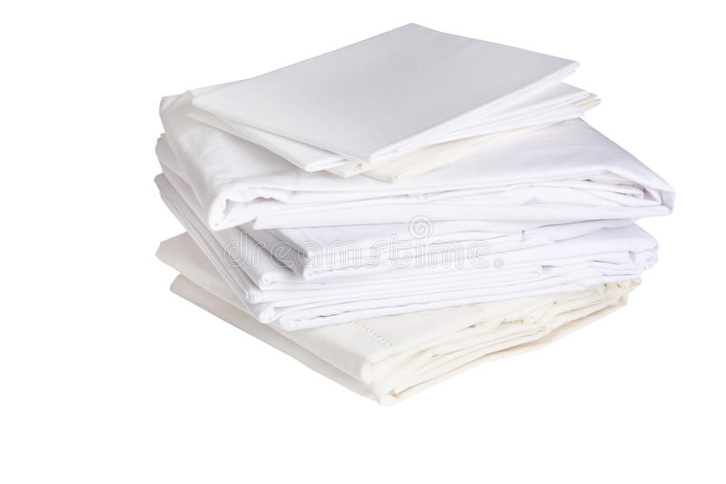 Pile of ironed white bed sheets stock image