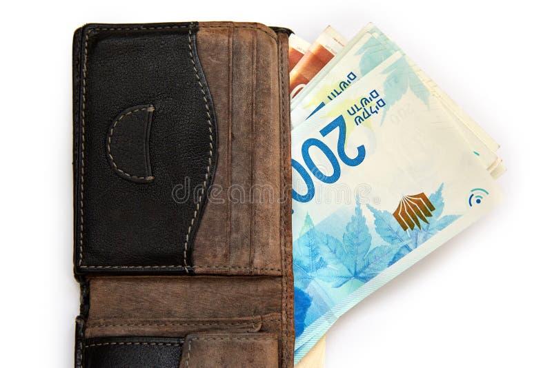 Pile israélienne d'argent du nouvel Israélien 200 shekels dans des billets de banque de factures d'argent sur le blanc images libres de droits