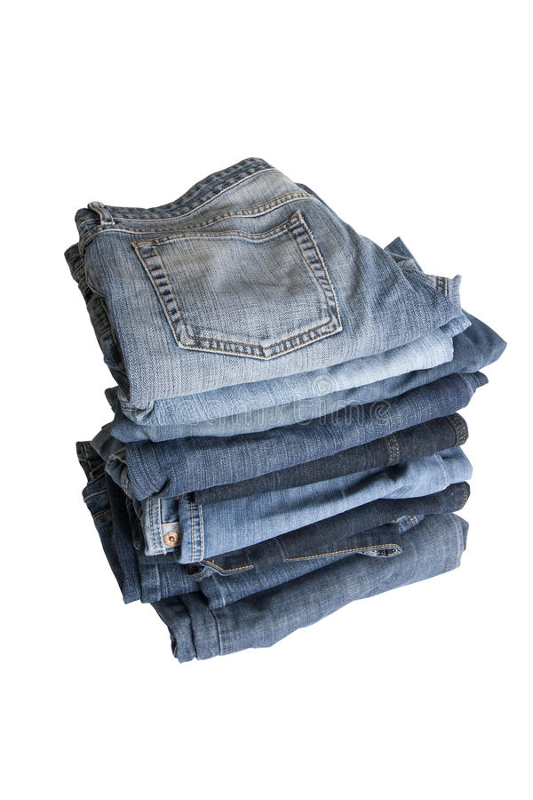 Pile of jeans. Jeans in a tall pile on a white background royalty free stock images