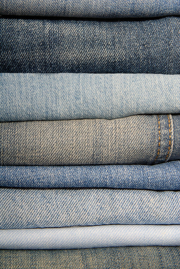 A pile of jeans stock photos
