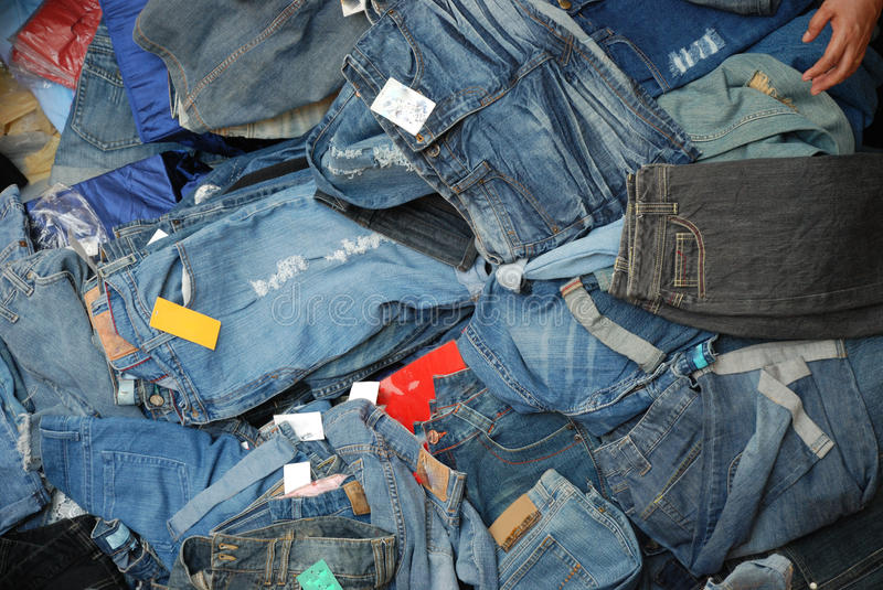 A Pile Of Jeans denim Pants. A top viewing photo taken on a pile of jeans denim wear on display for sale royalty free stock photography
