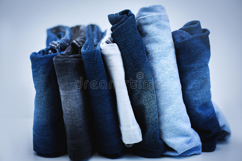 Pile of Jeans. Over grey stock photography
