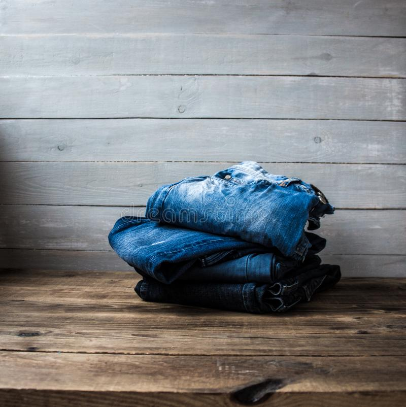 A pile of jeans stock photo