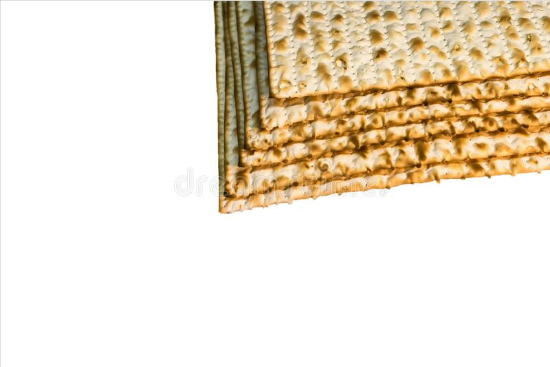Pile of Jewish Matzah bread, substitute for bread on the Jewish Passover holiday. Pesach matzo on white background royalty free stock image