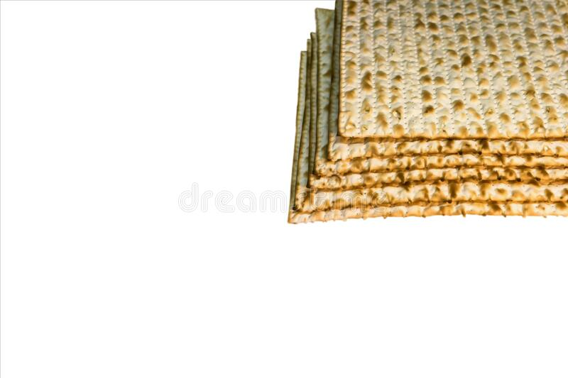 Pile of Jewish Matzah bread, substitute for bread on the Jewish Passover holiday. Pesach matzo on white background stock image