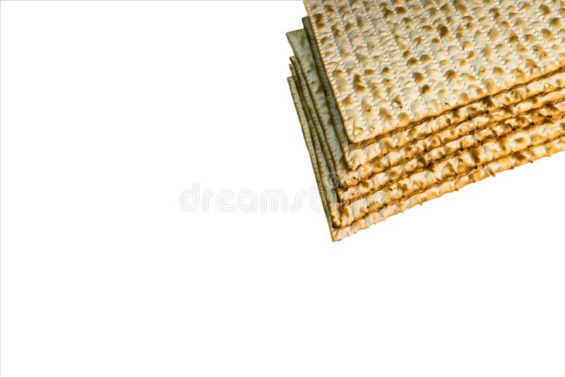 Pile of Jewish Matzah bread, substitute for bread on the Jewish Passover holiday. Pesach matzo on white background royalty free stock photo