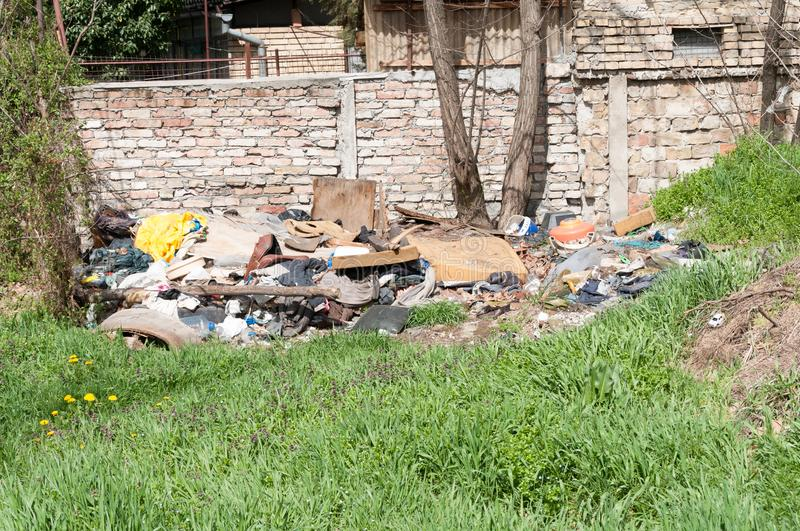 Pile of junk and garbage dumped in the nature or park in the city polluting the environment with bad smell royalty free stock photography