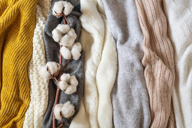 Pile of knitted clothes with cotton, warm background, knitwear, space for text, Autumn winter concept. Copy Space royalty free stock images