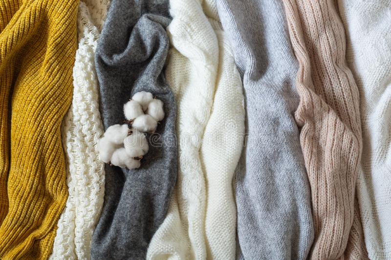 Pile of knitted clothes with cotton, warm background, knitwear, space for text, Autumn winter concept. Copy Space stock photos