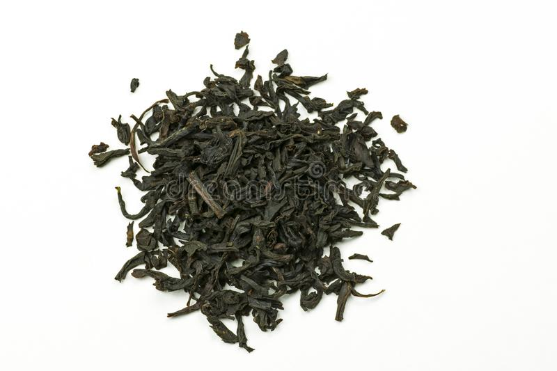 Pile of leaves Earl Gray black tea on white background stock images