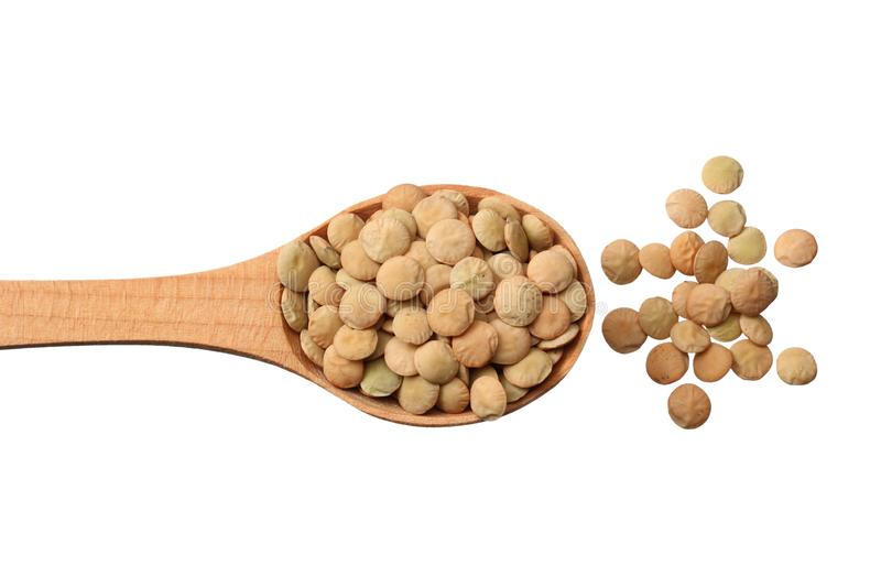 Pile lentil in wooden spoon isolated on white background. Top view royalty free stock image