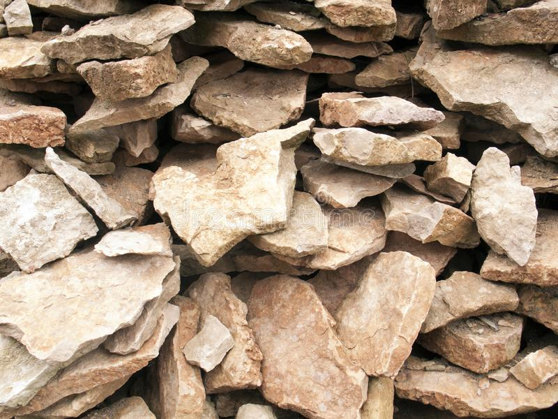 Pile of light natural stone pieces. May be used as background royalty free stock image