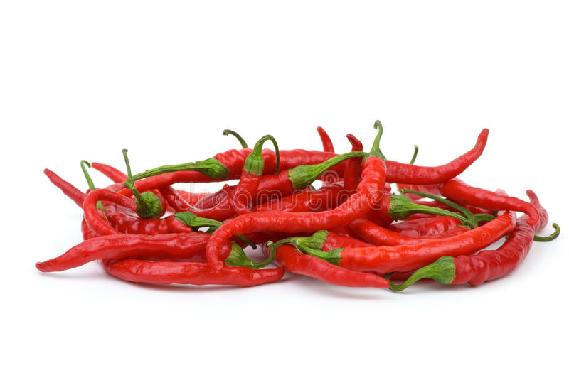 Pile of long curved red hot chili peppers stock photo