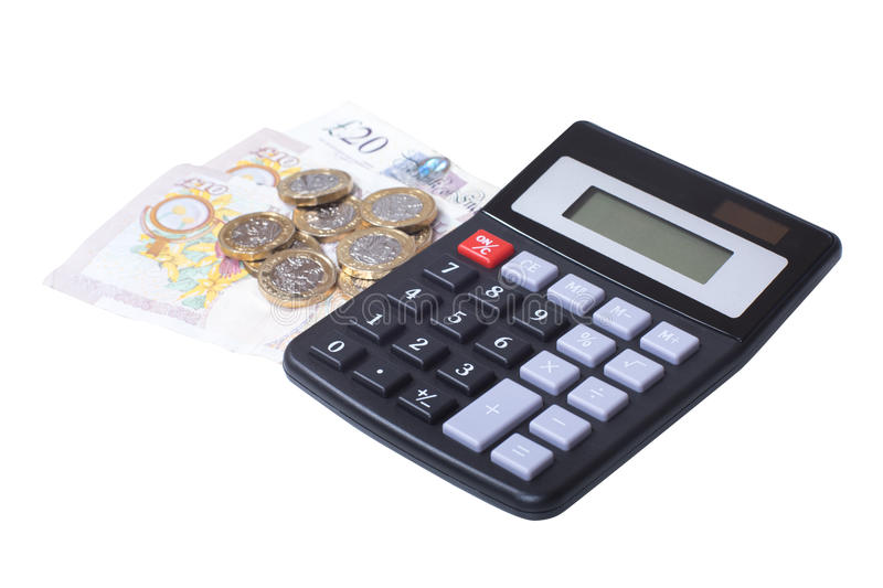 Pile of loose cash with a calculator stock photos
