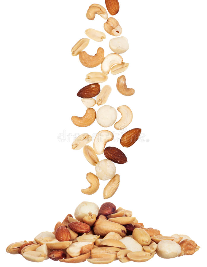 Pile of macadamia, almond and cashew nuts isolated royalty free stock photos