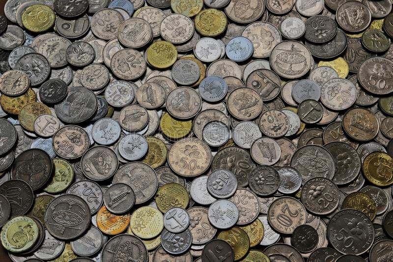 Pile Of Malaysian Coins. Top-down view of a pile of assorted Malaysian coins that is in circulation in the year 2018 stock photography