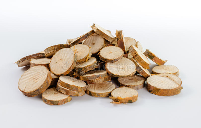 Pile of many little round pieces of sawn pine branches. On white background royalty free stock photos