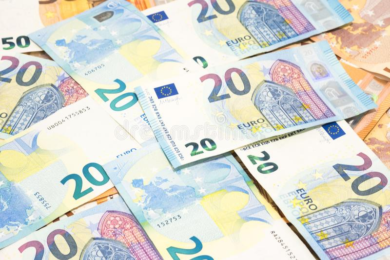 Pile of many twenty euro banknotes use for money or currency background. royalty free stock photos
