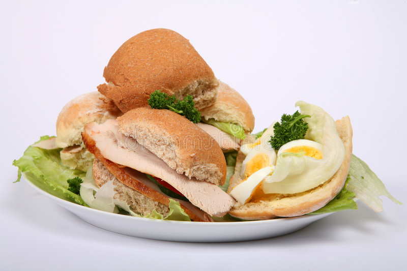 Pile of meat and salad sandwiches royalty free stock image