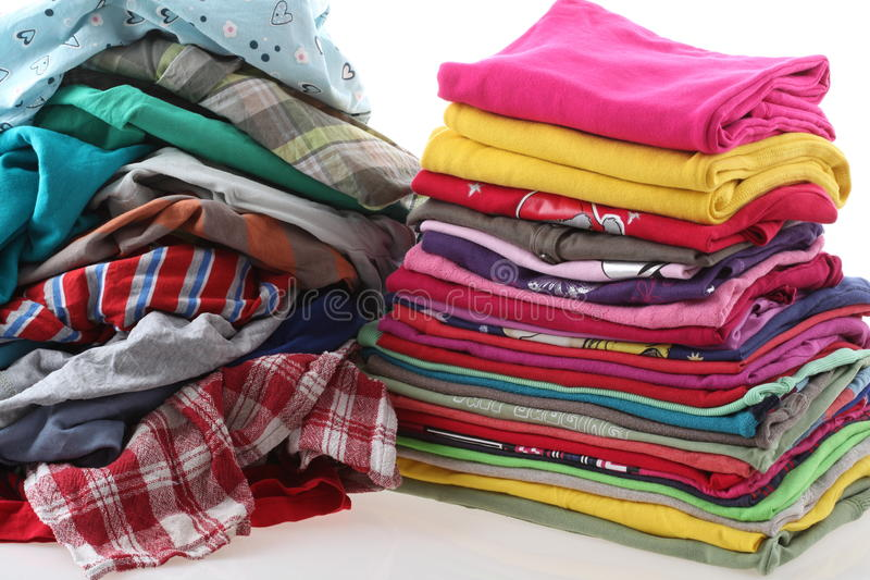 Pile of messy and ironed clothes. Heap of clothes with ironed shirts, isolated background stock images