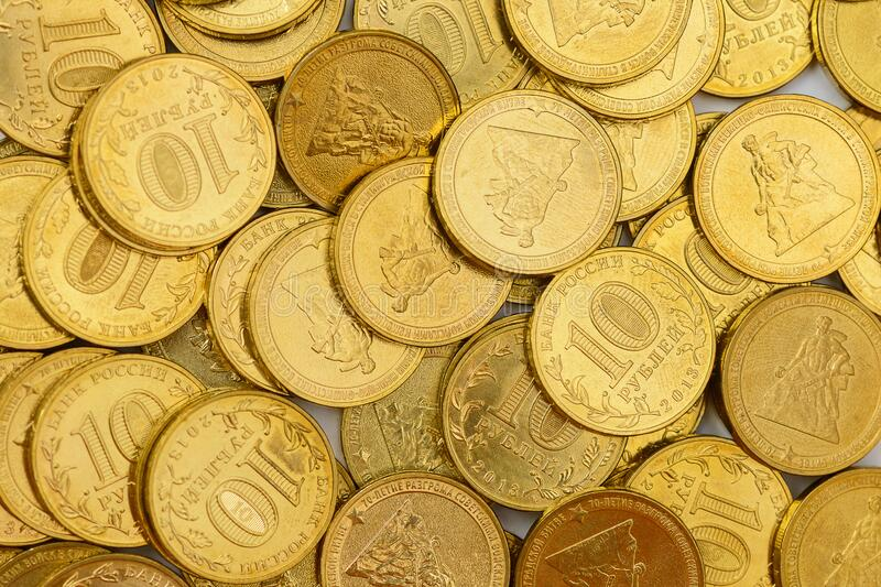 Pile of metal Russian coins 10 rubles. A pile of metal Russian coins 10 rubles stock images