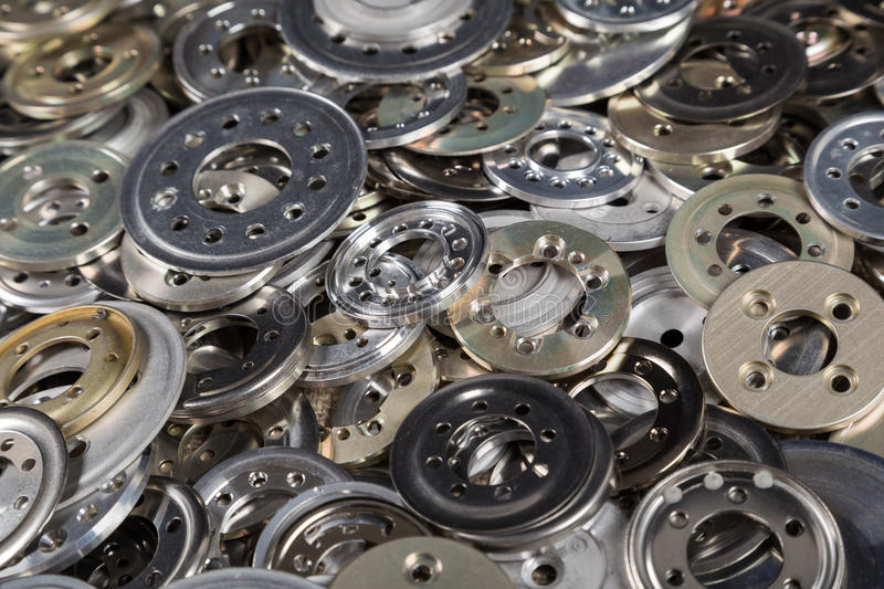 Pile of metal spacers. Pile of variety metal spacers, industrial background royalty free stock images