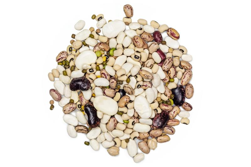 Mixed Legumes over white background. Pile of mixed legumes over white top view stock images
