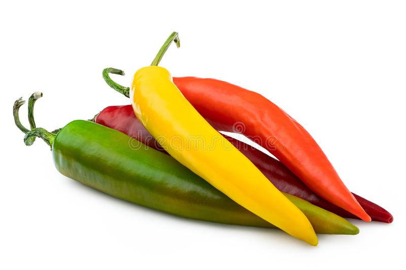 Pile of mixed red, yellow, orange and green cayenne chillies isolated on white stock photography