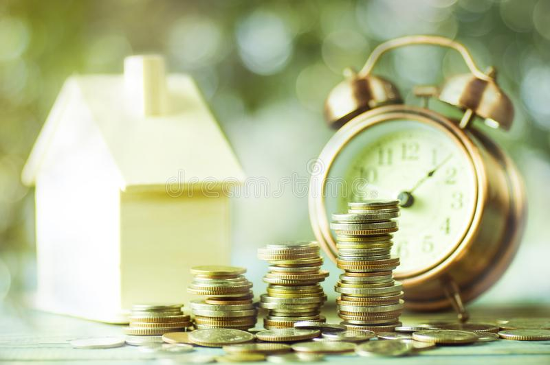 Pile of money, coins growing up, concept in business about loan, selling,finance and buying home. House stock image