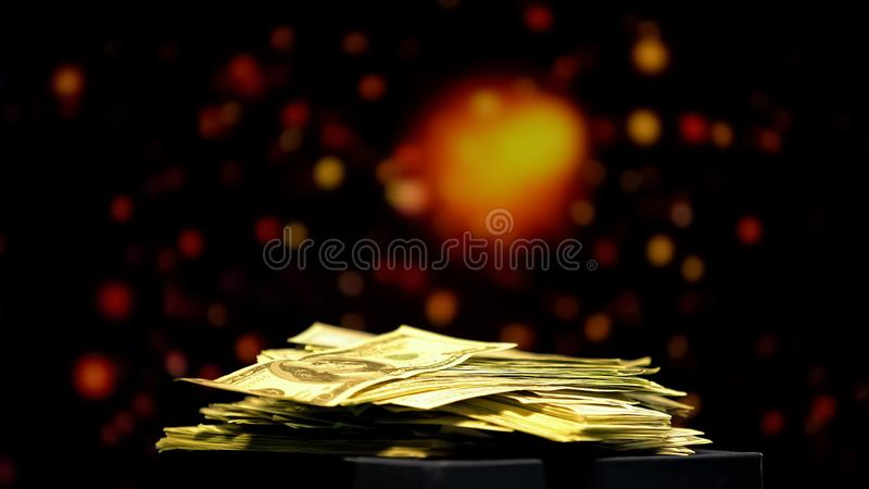 Pile of money on sparkling background, winnings in casino, successful bets. Stock photo royalty free stock images