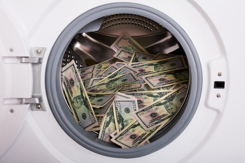 Pile Of Money In Washing Machine royalty free stock images